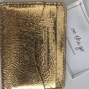 Anthropologie gold card holder